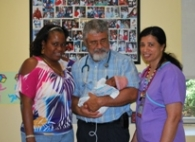 "Natacha Roachall (mother), neonatologist Dr. Patrick Leblanc and Nurse Mary Pappy with Natacha's 23-week ""miracle baby"" Faithe"