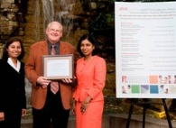 Terry Pugno, M.D. presents 2010 AAFP Foundation Pfizer Immunization Award to Vasantha Kondamudi, M.D. (right) and Sherly Abraham, M.D. (left) of TBHC's Department of Family Medicine.