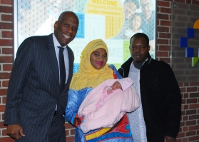 Leroy Charles, Vice President, External Affairs, welcomes Haleema, and her parents, Thierno and Lamarana Barry