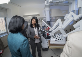 Pratibha Vemulapalli, Chair of Surgery at TBHC, shows off the robot