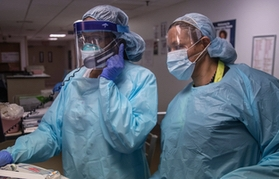Doctors in protective gear in TBHC emergency room