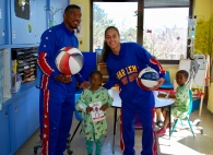 "Harlem Globetrotters Buckets Blakes and Briana ""Hoops"" Green with pediatric patient"