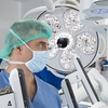Dr. Luca Milone, Director of Robotic Surgery at The Brooklyn Hospital Center, and the da Vinci Xi robot